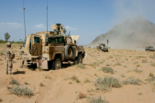 The OMLT Nyala sits broken down in the desert. [PHOTO: ADAM DAY]