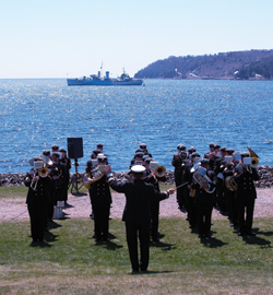 The ceremony at Point Pleasant Park in Halifax proceeds with HMCS Sackville a short distance away. [PHOTO: VETERANS AFFAIRS CANADA]