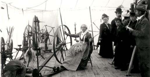 A spinning wheel at the 1903 Canadian National Exhibition. [PHOTO: ARCHIVES OF ONTARIO—RG-2-71, J-97]