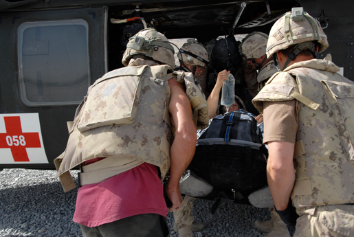 Medical staff load a Canadian soldier into a helicopter. [CANADIAN FORCES COMBAT CAMERA]