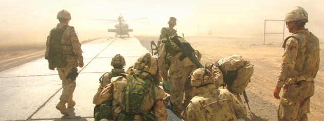 Wounded Canadian soldiers in Afghanistan await helicopter evacuation. [PHOTO: CPL. ROBIN MUGRIDGE]