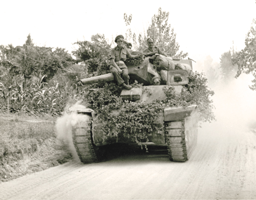 A Canadian tank on the move near Montevarchi, Italy, July 1944. [PHOTO: LIBRARY AND ARCHIVES CANADA—PA160454]