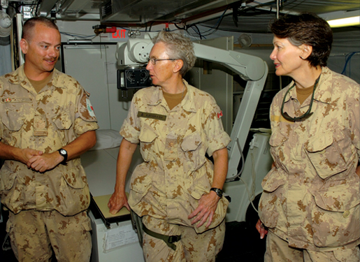 At the multinational, Canadian-led hospital at Kandahar Airfield in Afghanistan, technician Sgt. Dave Mann (left) discusses equipment with then-Commodore Margaret Kavanagh and Dr. Ruth Collins-Nakai, then president of the Canadian Medical Association.[PHOTO: CPL. ROBIN MUGRIDGE, TASK FORCE AFGHANISTAN, ROTO 1 IMAGERY TECHNICIAN]