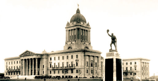 The Golden Boy statue sits atop the Manitoba Legislative Building while a First World War memorial (foreground) is a reminder of war's cost. [PHOTO: ARCHIVES OF MANITOBA—N16379]