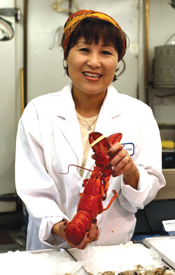 Cathy Konkel sells seafood for Domenic's in the market. [PHOTO: ST. LAWRENCE MARKET]