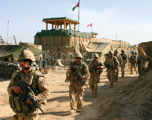 A Bravo Company patrol heads out of PSS Haji Beach. [PHOTO: ADAM DAY]