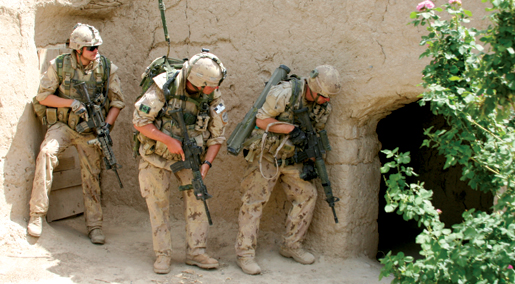 Troops stack up near the door for a compound-clearing operation. [PHOTO: ADAM DAY]