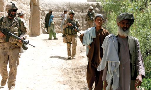 Villagers and Bravo Company soldiers walk together near Haji. [PHOTO: ADAM DAY]