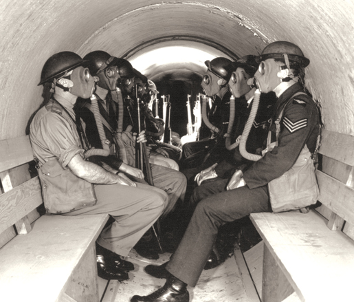 Personnel occupy an air raid shelter at Patricia Bay, B.C. [PHOTO: CANADIAN FORCES—PL9605]