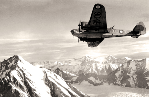 An aircraft of No. 8 Sqdn. on patrol over snow-capped mountains. [PHOTO: CANADIAN FORCES—RE20468]