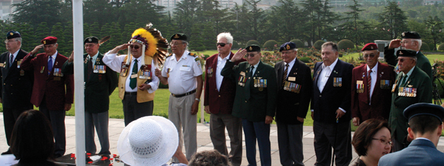 Aboriginal and Métis veterans representatives join in a sunrise ceremony at the United Nations Memorial Cemetery. [PHOTO: TOM MACGREGOR]