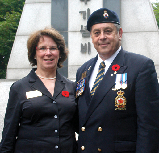 Veterans Affairs Deputy Minister Suzanne Tining joins Legion representative Michael Cook at Naechon. [PHOTO: TOM MACGREGOR]
