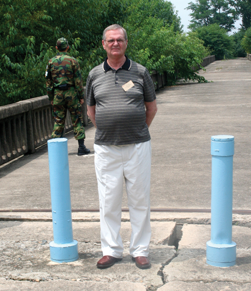 "Former prisoner of war Jim Gunn stands on ""the bridge of no return"". [PHOTO: TOM MACGREGOR]"
