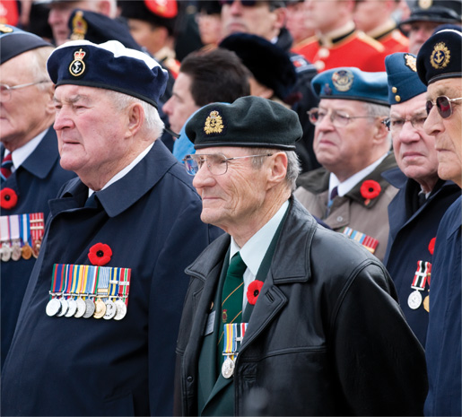 Veterans stand proudly  during the ceremony. [PHOTO: METROPOLIS STUDIO]