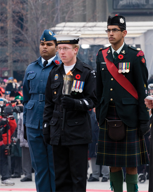 Petty Officer First Class Brian Rainbow (front),  Flight Sergeant Paras Satija (left) and Master Warrant Officer Shawn Claire. [PHOTO: METROPOLIS STUDIO]