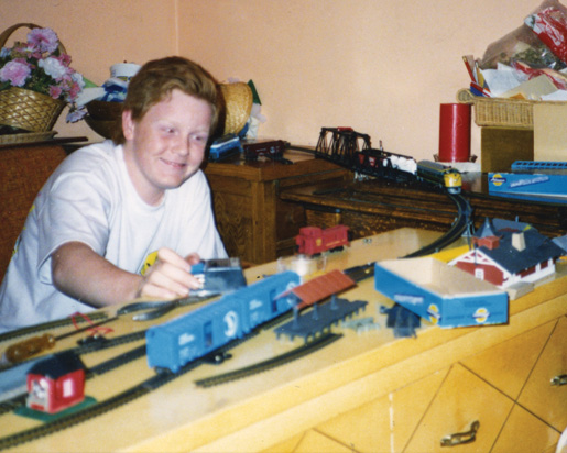 Younger days spent with his train set. [PHOTO: COURTESY NICOLE DOYLE]