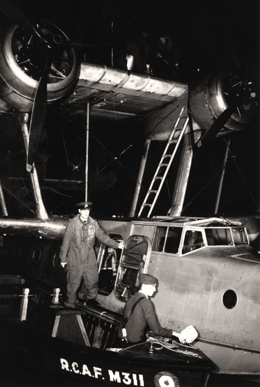 A boat is used to refuel a Stranraer flying boat near Bella Bella. [PHOTO: CANADIAN FORCES—PL9578]