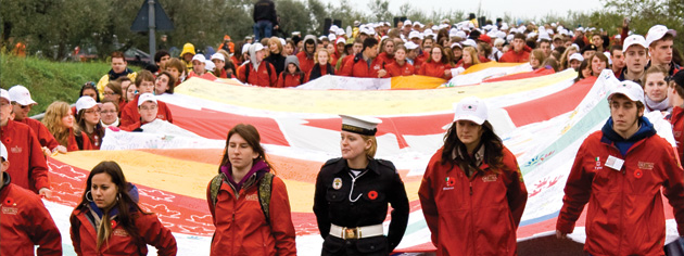 More than 1,200 students march from the Moro River Canadian War Cemetery to Ortona with their Hands Across The Generations Flag. [PHOTO: DAN BLACK]