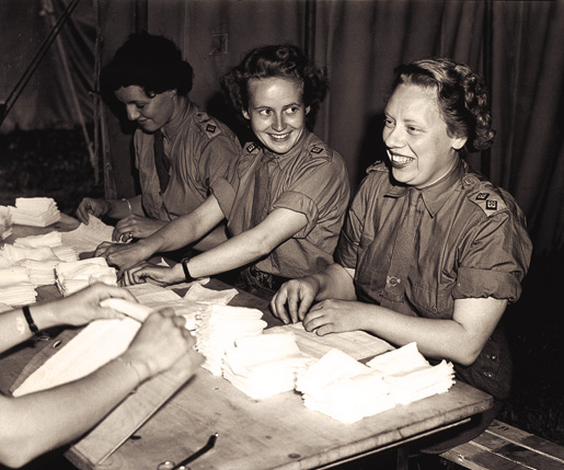 Nursing sisters of the Royal Canadian Army Medical Corps wrap bandages at a British hospital in Normandy, July 17, 1944. [PHOTO: LT. FRANK L. DUBERVILL, LIBRARY AND ARCHIVES CANADA–PA190096]