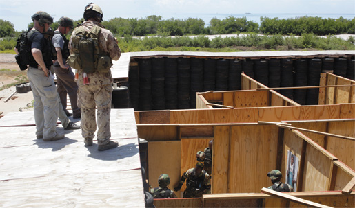 Members of DFAIT, CSOR and CANSOFCOM watch activities in the kill house from above. [PHOTO: ADAM DAY]