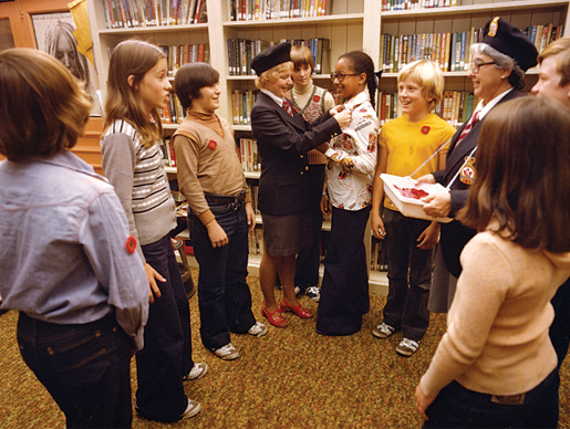 Members of the Ladies Auxiliary visit a school during the poppy campaign in the mid-1970s. [PHOTO: LEGION MAGAZINE ARCHIVES]