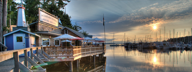 The sun sets on Lund marina and boardwalk. [PHOTO: SUNSHINE COAST TOURISM]
