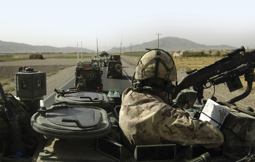 Canadian soldiers halt traffic west of Kandahar in order  to check for improvised explosive devices. [PHOTO: MASTER CORPORAL ROBERT BOTTRILL, CANADIAN FORCES COMBAT CAMERA]