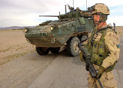 Corporal Adam Neid stands guard near a LAV. [PHOTO: CORPORAL ROBIN MUGRIDGE, CANADIAN FORCES]
