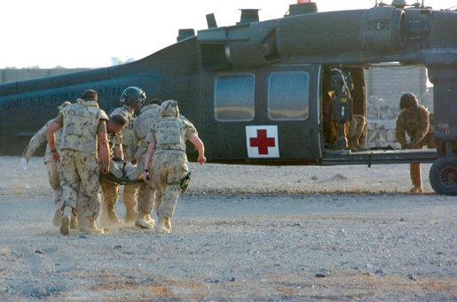 An injured soldier is evacuated. [PHOTO: SERGEANT LOU PENNEY, CANADIAN FORCES]