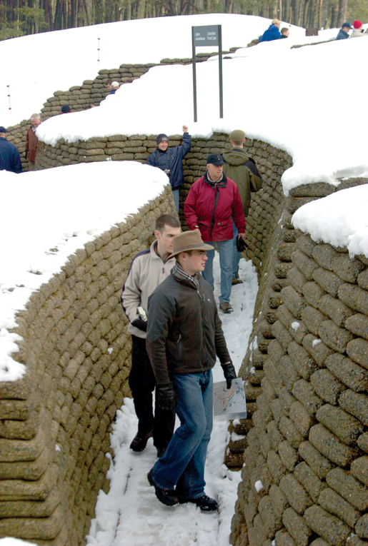 officer cadets from the Royal Military College examine a restored trench at Vimy Ridge in France. [PHOTO: ADAM DAY]