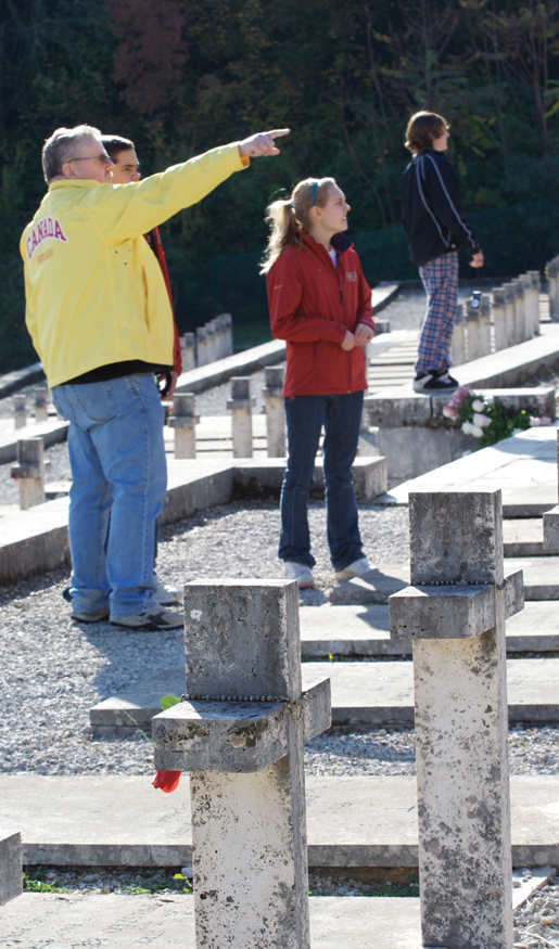 Teacher Dave Robinson and students visit the Polish military cemetery at Monte Cassino, Italy, in 2008. [PHOTO: DAN BLACK]