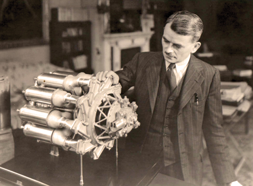 Frank Whittle examines a quarter-scale model of a turbo-jet engine. [PHOTO: ROY FOWKES]