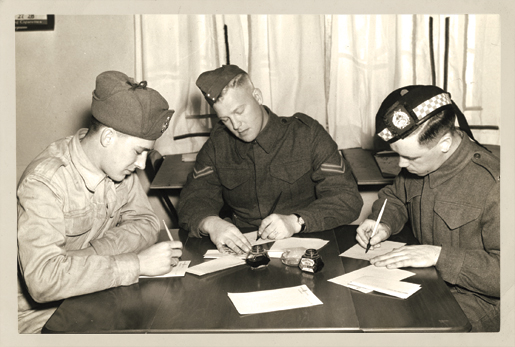 Soldiers write home in January 1941. [PHOTO: WILLIAM KENSIT, EDMONTON]