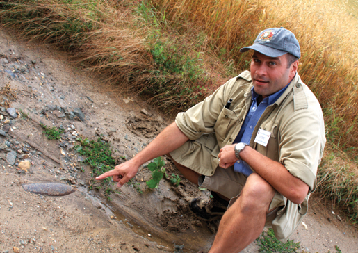 Tour guide John Goheen points to an unexploded shell from the First World War. [PHOTO: SHARON ADAMS]