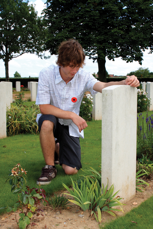 Jacob Durocher visits a relative's grave at Bretteville-sur-Laize Canadian War Cemetery in Normandy. [PHOTO: SHARON ADAMS]