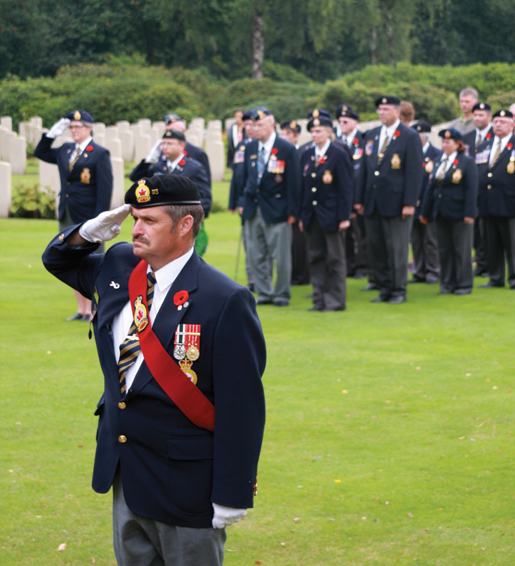 Sergeant-at-Arms Brian Vessey salutes at Holten Canadian War Cemetery in the Netherlands. [PHOTO: SHARON ADAMS]