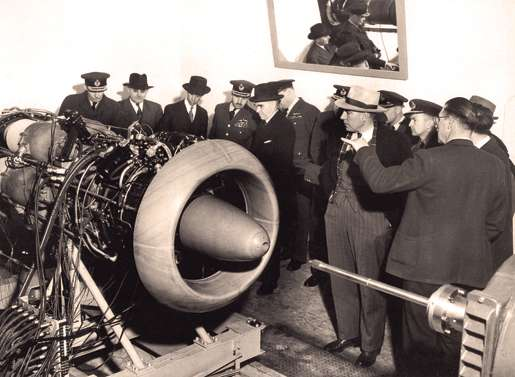 RCAF officers and other officials examine a Chinook jet engine, March 1948. [PHOTO: LIBRARY AND ARCHIVES CANADA—PA121835]