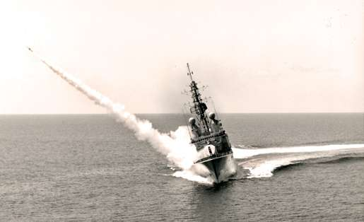 HMCS Iroquois fires a Sea Sparrow anti-aircraft missile during a high-speed turn off Puerto Rico, 1976. [PHOTO: CANADIAN FORCES]