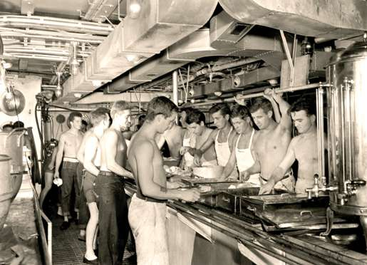 Dinner is served on board HMCS Prince Robert, November 1945. [PHOTO: JACK HAWES, LIBRARY AND ARCHIVES CANADA—PA166444]