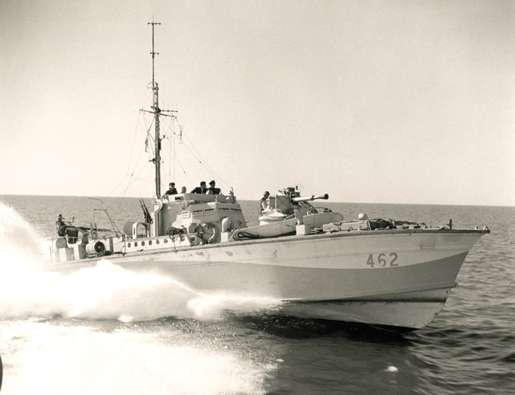 Motor Torpedo Boat 462 races into action, 1944. [PHOTO: GILBERT MILNE, LIBRARY AND ARCHIVES CANADA—PA144574]