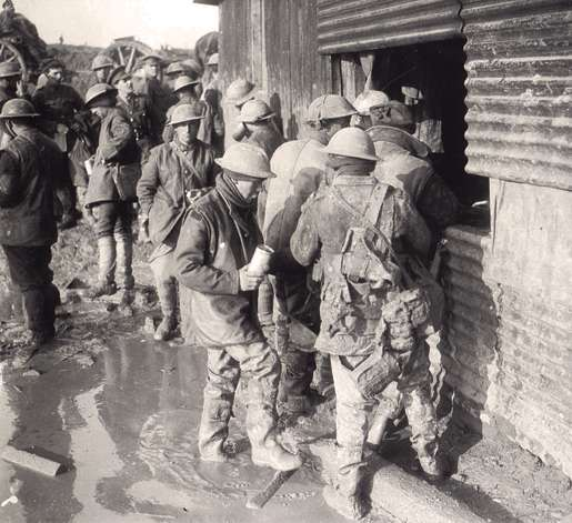 Canadian soldiers line up at a canteen, November 1916. [PHOTO: DND/LIBRARY AND ARCHIVES CANADA—PA000930]