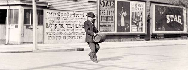 A man carries a keg during prohibition, September 1916. [PHOTO: JOHN BOYD, LIBRARY AND ARCHIVES CANADA—PA069965]