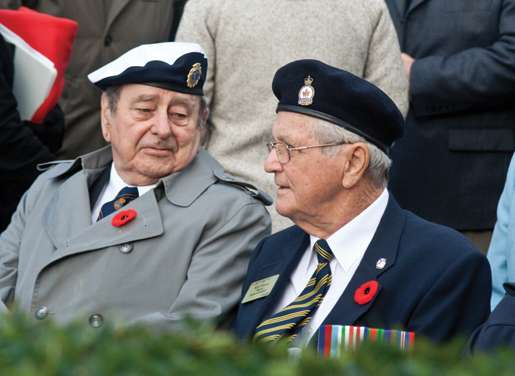 Veterans Dusty Miller and Roland Demers chat before a ceremony begins. [PHOTO: TOM MacGREGOR]