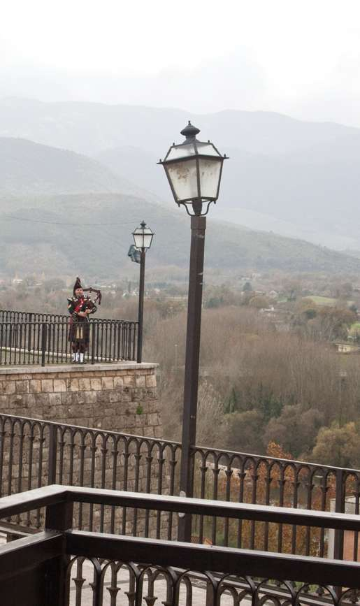 Piper Sergeant William MacDougall plays from the walls of Pontecorvo overlooking the Liri Valley. [PHOTO: TOM MacGREGOR]