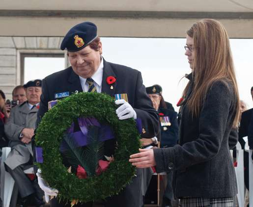 Legion First Vice Pat Varga places a wreath at the Cassino War Cemetery assisted by youth representative Mélanie Morin. [PHOTO: TOM MacGREGOR]