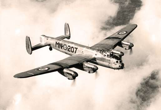 Postwar work for Lancaster MN-207 included aerial surveys. [PHOTO: NATIONAL DEFENCE—PL102456]
