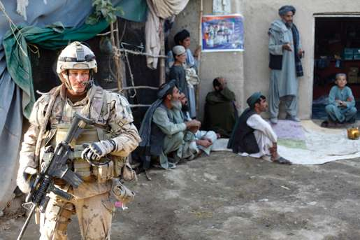 Sergeant Dwayne MacDougall at the Afghan shop just south of the platoon house. [PHOTO: ADAM DAY]
