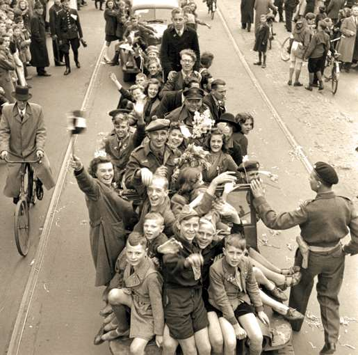 Joyful Dutch civilians and Canadian soldiers celebrate the liberation of Utrecht, May 7, 1945. [PHOTO: ALEXANDER STIRTON, LIBRARY AND ARCHIVES CANADA—PA140417]