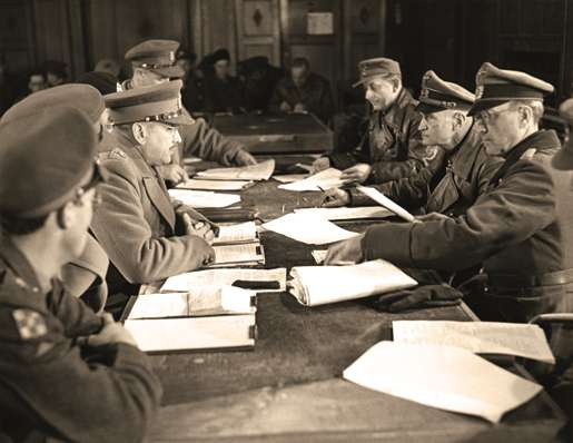 Lt.-Gen. Charles Foulkes (left centre) accepts the surrender of German forces in the Netherlands, May 5, 1945. [PHOTO: ERNEST J. DeGUIRE, LIBRARY AND ARCHIVES CANADA—PA134408]