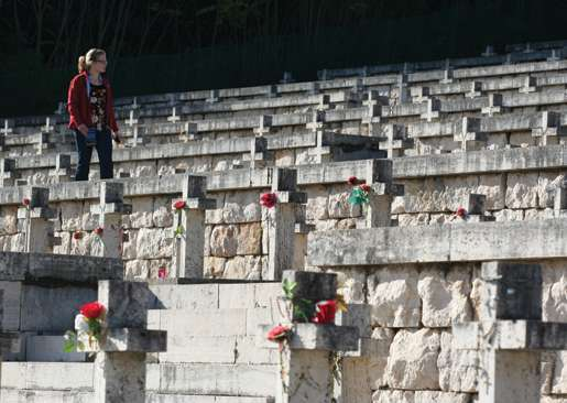 A Canadian student visits the Polish military cemetery on Monte Cassino. [PHOTO: DAN BLACK]